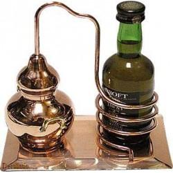 Миниатюрный аламбик с бутылкодержателем на медной подставке.